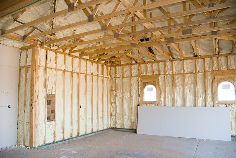 8688516 - a room at a newly constructed home is sprayed with liquid insulating foam before the drywall is added. ideal for new home construction advertising and other home construction promotional inferences.